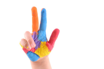 Colorful hand of a kid with three fingers up