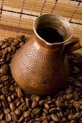 Coffe beans and jezve. Macro.
