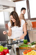 Young couple cook in modern kitchen
