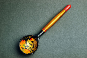 Russian national artistic wooden spoon on black texture