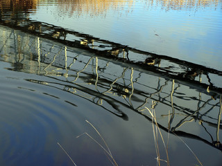 Metal construct over river reflected