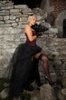 Beautiful blonde girl wearing corset and high heels