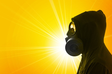 Man in hoody with gas mask