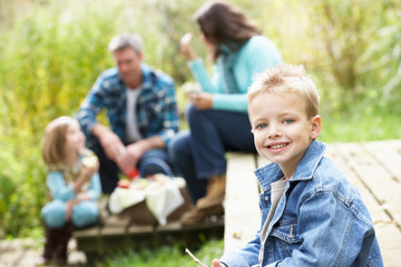 Parents And Children Having Picnic In Countryside