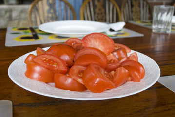 Fresh sliced tomatoes on a plate