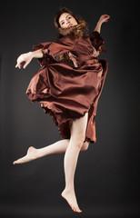 Beautiful dancer jumping on dark
