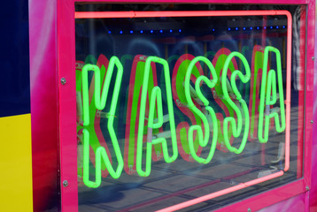 "Green neon lights spelling ""kassa"" in fluorescent green"