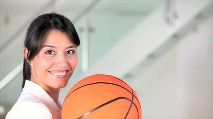 Business woman catching a basketball