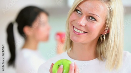 Women eating an apple