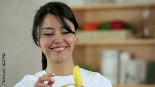 Woman eating a banana