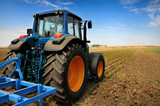 Fototapety The Tractor - modern farm equipment in field