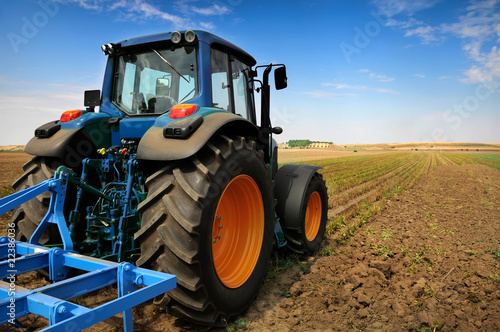 Fotobehang Planten The Tractor - modern farm equipment in field