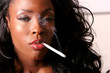 Beautiful african american woman smoking cigarette