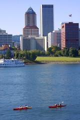 Kayaks on the river & Portland OR.,skyline.