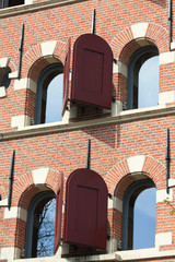 Historic dutch facade, windows with shutters