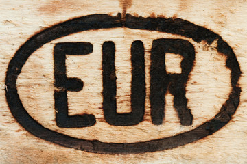 European sign engraved on a piece of wood