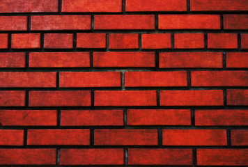 Wall from a red brick in a grunge style