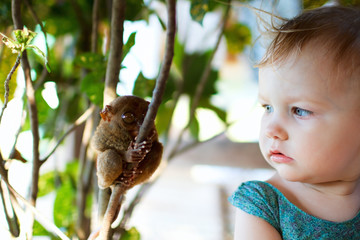 Girl and tarsier