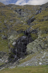 Waterfall from mountain glacial lake
