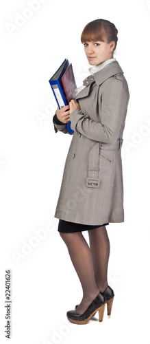 Businesswoman with book in black suit isolated on white