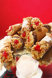 Sicilian filled Cannoli on red