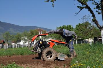 Farmer repair tractor