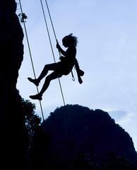 Climbing woman silhouette