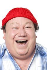 homme joufflu portant un bonnet rouge