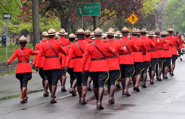 troop of Canadian mountie police marching