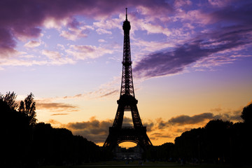 Eiffel Tower against a coloful sunset
