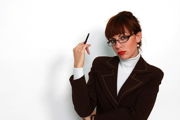 woman with eyeglasses holding a pen in her hand