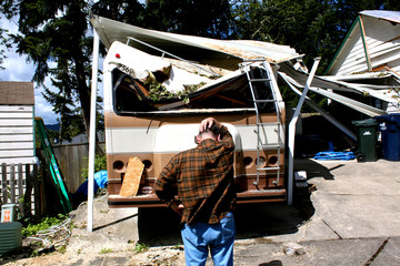 man and damaged rv waiting for insurance
