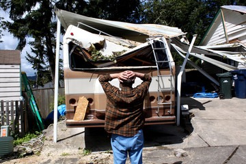 man and damaged rv