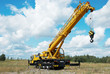mobile crane with risen boom outdoors - 22435844