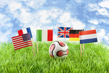 Flags and ball on soccer field