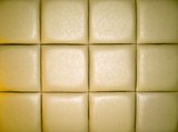 Pale Tan Leather Upholstry Background with a Repetitive pattern poster