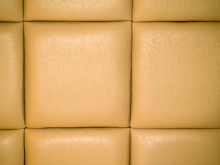 Tan Leather Upholstry Background with a Repetitive pattern