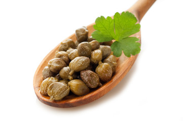 capers with parsley over the spoon