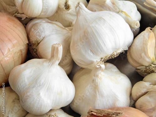 Cloves of garlic and onions.