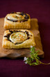 Puff pastry goat's cheese and red  onion small tarts
