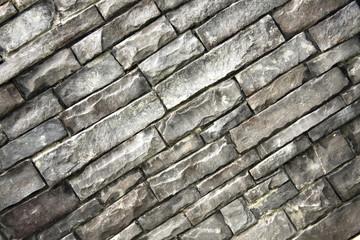 Diagonal grey rock background