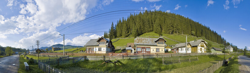 Traditional village of northern Romania along the road