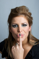 attractive blonde woman making a gesture of silence with his fin