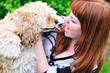 redheaded girl having fun with her dog