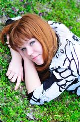 laying spring redheaded girl