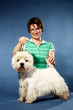woman and West Highland White Terrier in pose