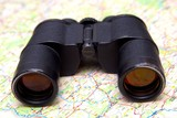 Binoculars and map