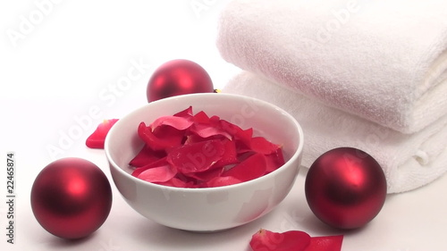 Spa towels holiday ornaments and rose petals - HD