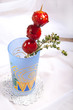 sweet cherry tomato in colorful glass