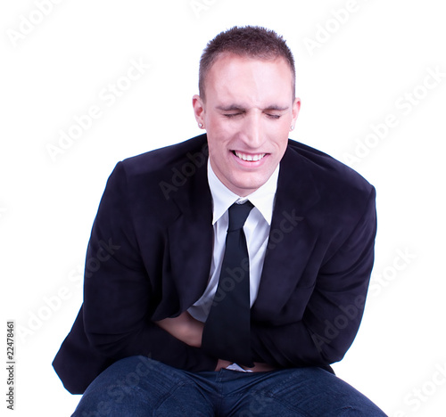 Businessman in pain holding his stomach